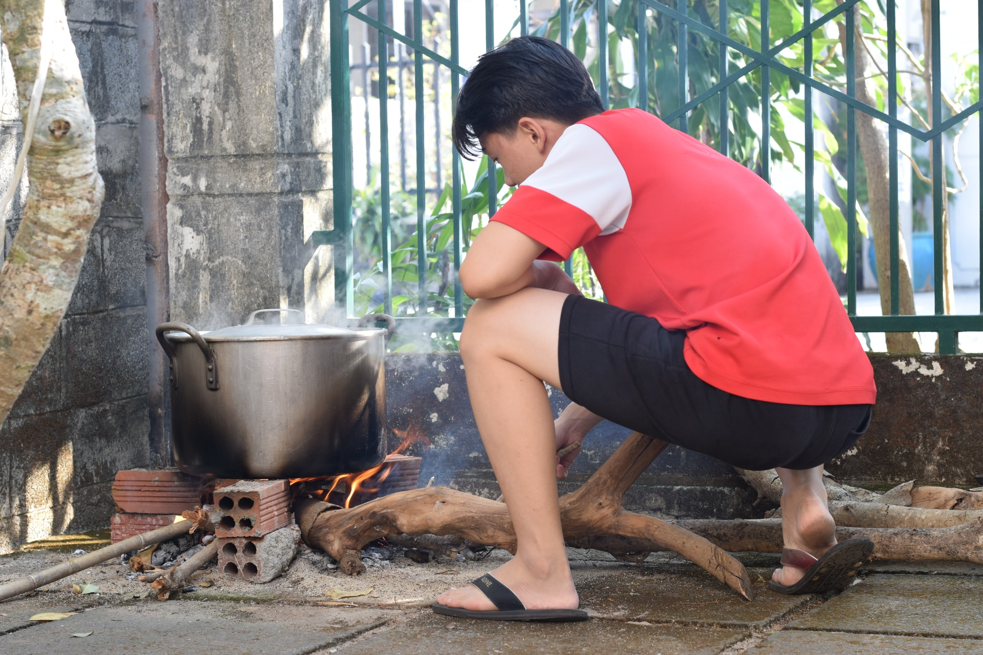 person cooking rice