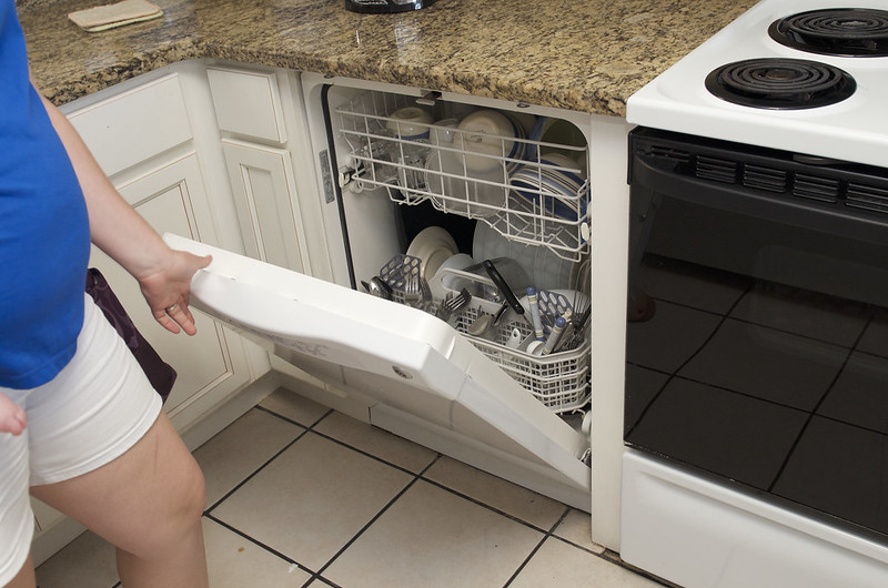 lots of dishes in dishwasher